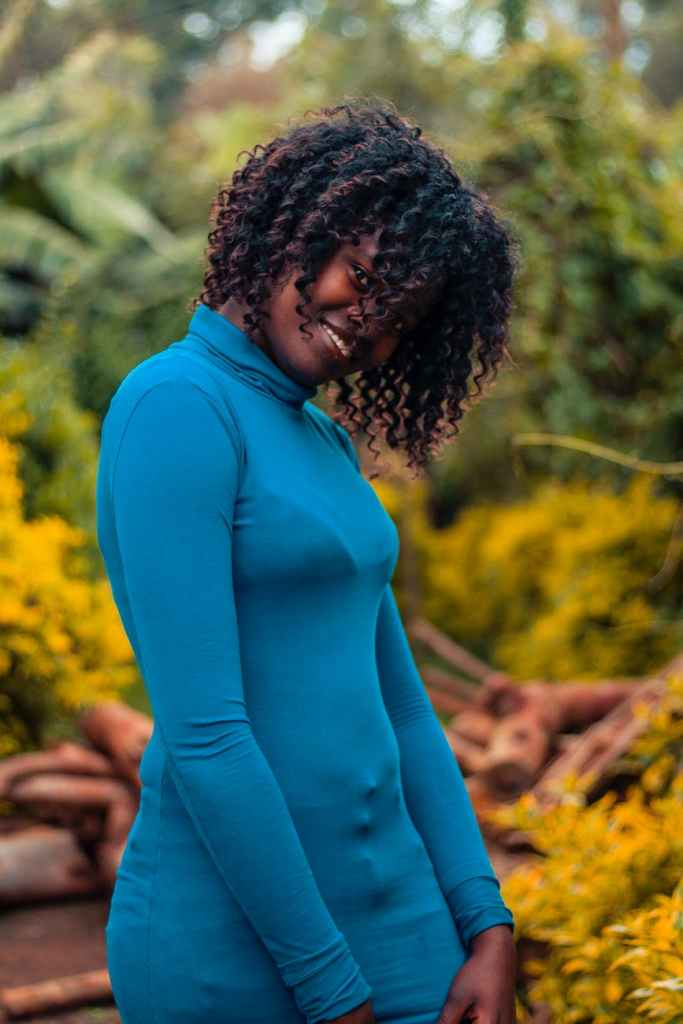 selective focus photo of woman wearing blue turtleneck long sleeved top